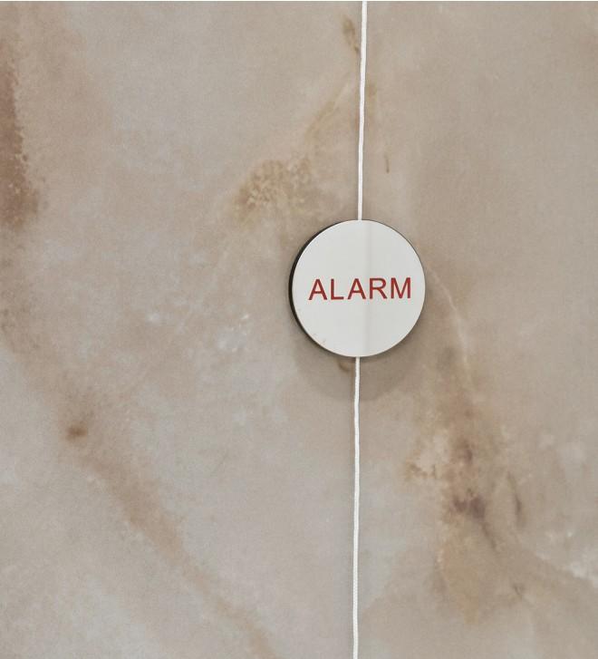Alarmschild für die Dusche